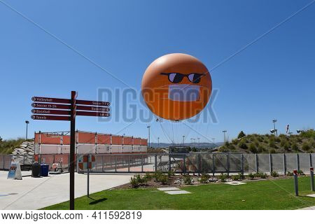 IRVINE, CALIFORNIA - 30 AUG 2020: The Orange County Great Park Balloon with a COVID-19 face mask and sunglasses sits at the station.
