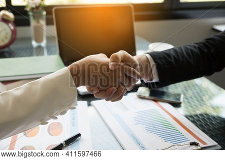 Two Confidence Businessman And Businesswoman Shaking Hands Close-up View Of Hands,negotiating Busine