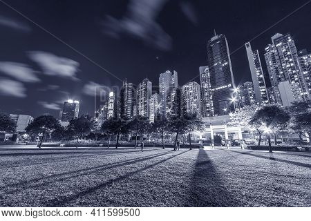 High Rise Office Building And Public Park In Downtown Of Hong Kong City At Night