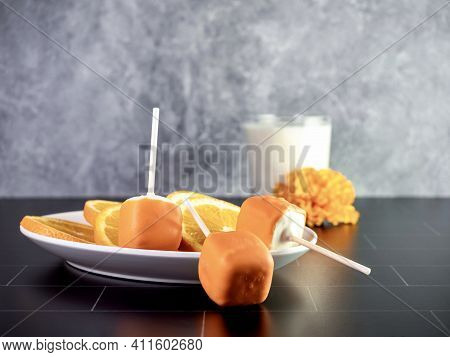 Orange Creamsicle Cake Pops On A Stick, Orange And White Dessert, Delicious Sweet Treat With A Glass