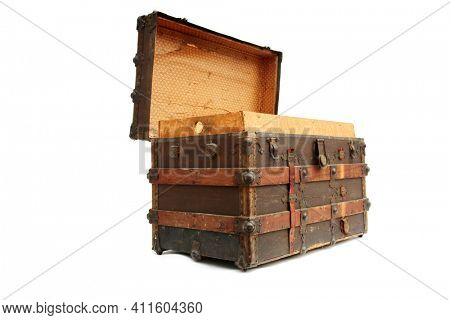 Steamer Trunk.Antique Steamer Trunk. Isolated on white. Steamer Trunks have been used as luggage for years to protect and move clothes and items while traveling the country or the world.