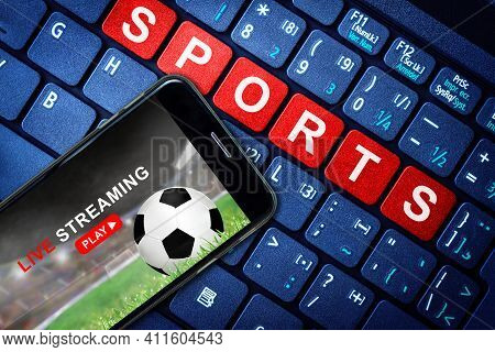 Sports Live Streaming Concept Showing Soccer Or Football Game Broadcast On Smartphone With Laptop Hi