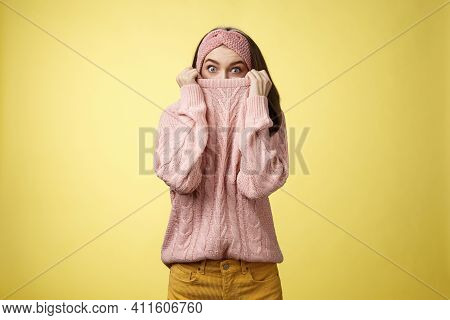 Girl Hiding In Collar Wearing Knitted Sweater Over Nose Popping Eyes, Staring Bugged Eyes At Camera,