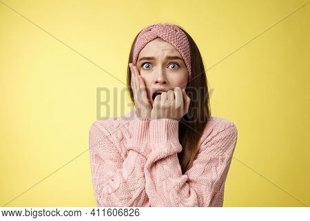 Shocked Frightened Stunned Cute Timid Girl Panicking, Standing In Stupor Biting Fist In Fear Staring