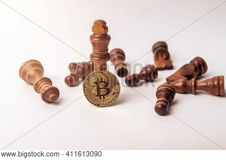 Bitcoin Coin Near King And Fallen Chess Figures Oon White Background