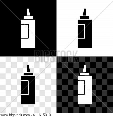 Glowing Neon Sauce Bottle Icon Isolated On Black Background. Ketchup, Mustard And Mayonnaise Bottles