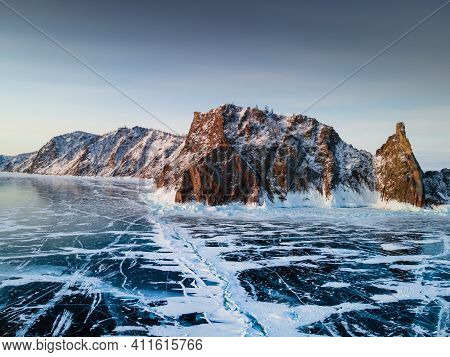 Baikal Lake In Winter With Transparent Blue Ice. Cape Khoboy Of Olkhon Island, Baikal, Siberia, Russ