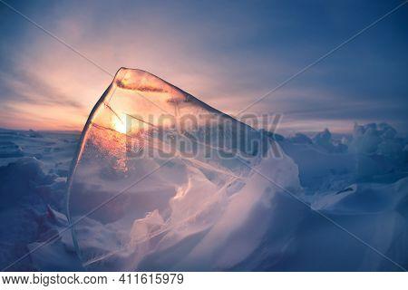 Ice On Winter Baikal Lake At Sunrise. Baikal, Siberia, Russia. Beautiful Winter Landscape. Selective