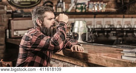 Beer Time. Man Drinks Beers At The Bar Counter. People, Lifestyle, Recreation. Man With Beer. Bearde