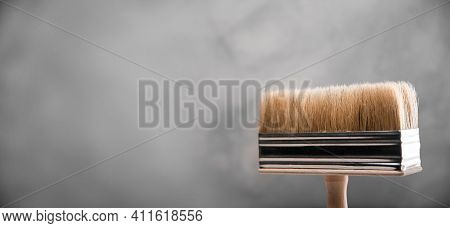 Clean Fresh New Paint Brushes For Painting On Gray Blurred Concrete Background. Close Up With Copy E