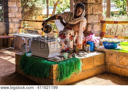 Yeha, Ethiopia - Feb 10, 2020: Young Woman In Traditional Clothing Is Preparing A Coffee Ceremony At
