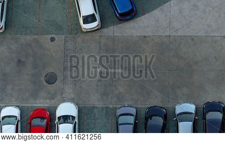 Top View Concrete Car Parking Lot. Aerial View Of Car Parked At Car Parking Area Of Apartment. Outdo