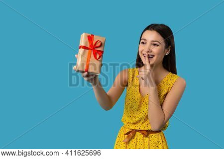 Pretty Young Caucasian Girl, Summer Clothes, Holding Index Finger At Lips, Asking To Keep Silence Or