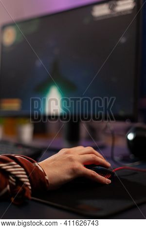 Close Up Of Gamer Using Mouse During Live Space Shooter Tournament In Gaming Home Studio. Pro Gamer