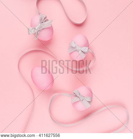 Simplicity Purity Easter Background - Pink Eggs With Curved Grey Ribbons On Pastel Pink, Square.