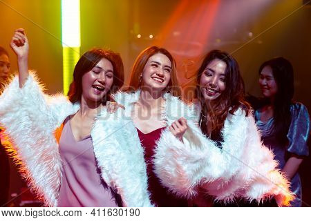 Group Of Women Friend Having Fun At Party In Dancing Club At Night . Social Gathering Event And Nigh