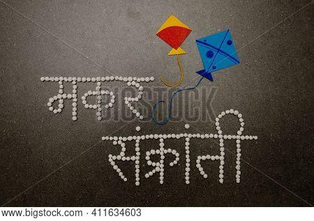 Makar Sankranti Typography In Devanagari Font Using White Coloured Halwa Or Sugar Balls