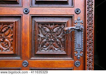 Close-up Of Vintage Wooden Hand-carved Door With Metal Handle In Prague, Czech Republic