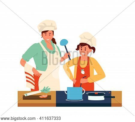 Mother With Daughter In Aprons And Chef Hats With Ladles Making Dinner Together. Family Activities.