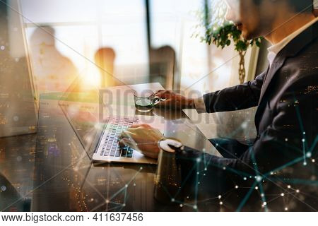 Man Teleworker Works At Home With A Laptop. She Is In Smart Working Due To Covid-19 Pandemic