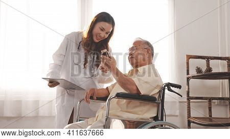Asian Female Nurse Tells How To Take Medicine To Elderly Senior Grandfather Patient At Home Medical