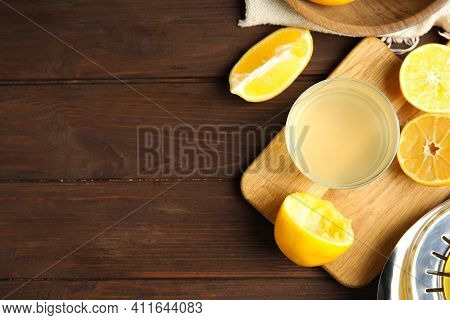 Freshly Squeezed Lemon Juice On Wooden Table, Flat Lay. Space For Text
