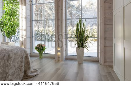 Bright Interior Of The Room In A Wooden House With A Large Window Overlooking The Winter Courtyard.