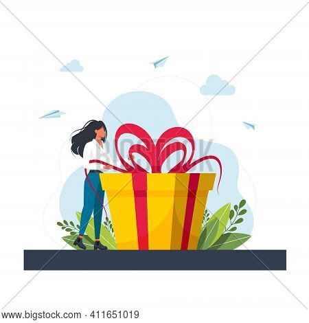 Loyalty Program For Regular Clients Concept.business Concept. Woman Holds Big Gift Box. Woman With A