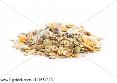 Beakfast cereals in bowl. Healthy muesli with oat flakes, nuts and raisins isolated on white background.