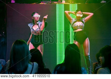 Techno Dancer In Night Club Dancing To The Beat Of Music From Dj . Edm New Year Night Party And Nigh
