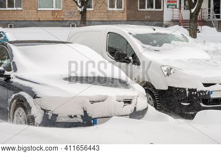 City Street After Blizzard. Stuck Cars Under The Snow And Ice. Buried Vehicle In Snowdrift On The Ro