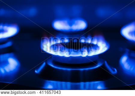 Gas Flame, Burning Burner Of A Gas Stove On A Black Background.