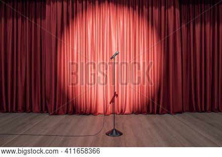 Speaker Performance Concept With Round Spotlight On Red Curtain And Microphone On Wooden Floor Of Em