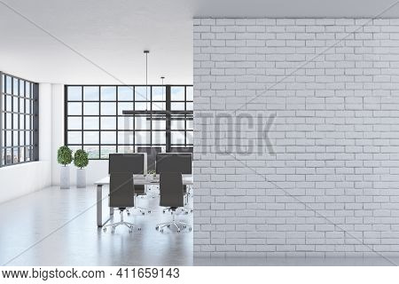 Blank White Brick Wall In Modern Spacious Office With Squared Window, Concrete Floor And Black Chair