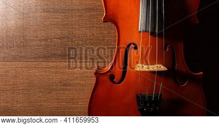 Violin, Details Of A Beautiful Violin On Wooden Surface And Black Background, Low Key Selective Focu