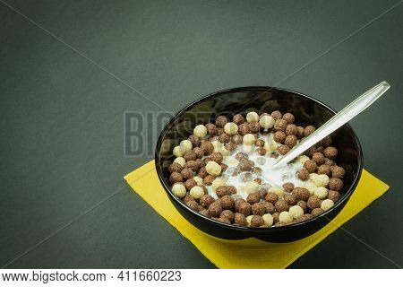 Round Chocolate Flakes With Milk. Balls Of Chocolate Flakes With Milk In A Black Dish. Healthy Break