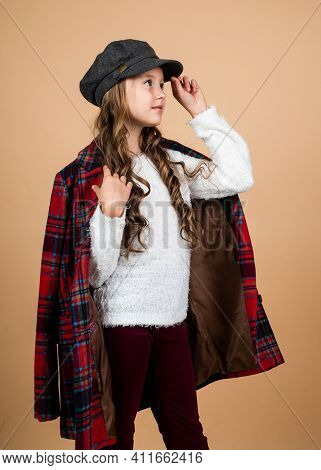 Teenage Girl In Checkered Jacket. Happy Childhood. Beauty And Fashion. Cheerful Parisian Child Has L