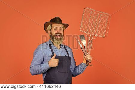 Culinary Concept. Summer Weekend. Happy Hipster Hold Cooking Utensils For Barbecue. Bearded Man Chef