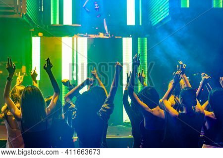 Silhouette Image Of People Dance In Disco Night Club To Music From Dj On Stage . New Year Night Part