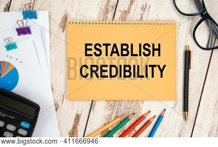 Notebook With Text - Establish Credibility, On The Office Table, Documents, Calculator, Glasses And