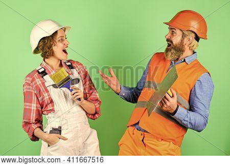 Home Renovation. Couple Is Renovating Home. Couple Doing Apartment Repair Together Themselves. Man A
