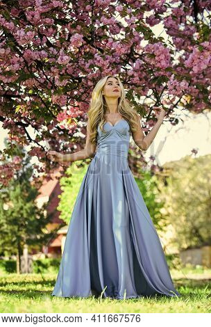 Hot Day. Girl With Blooming Sakura Tree. Spring Fashion Style. Real Female Beauty. Summer Weather An