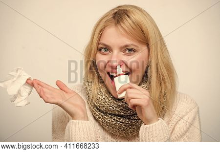 Squeezing The Pump. Unhealthy Girl With Runny Nose Using Nasal Spray. Cute Woman Nursing Nasal Cold