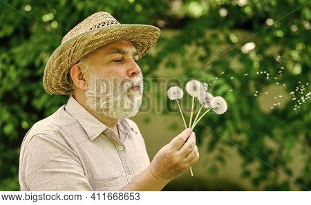 Tranquility And Serenity. Harmony Of Soul. Elderly Man In Straw Summer Hat. Happy And Carefree Retir