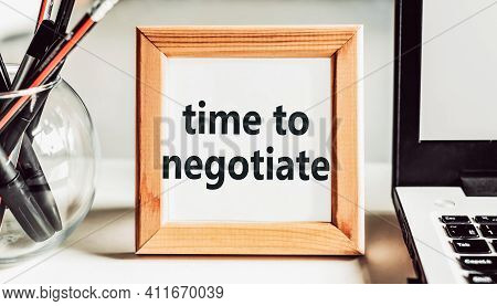 Time To Negotiate. Text In Wooden Frame On Office Table.