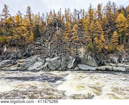 View Of The Rocky Shore Of The Wild Rapid Siberian River In Autumn. Siberian Fast Clean River With L