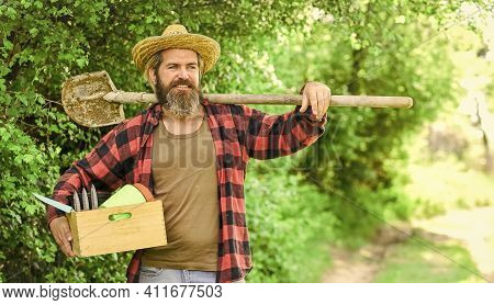 Look After Them And Store Them Carefully. Caucasian Farmer Countryside Nature Background. Tools For