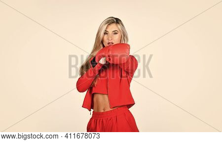 Sport Is Our Life. Beautiful Woman With Red Boxing Gloves. Young Sports Woman In Tracksuit And Boxin
