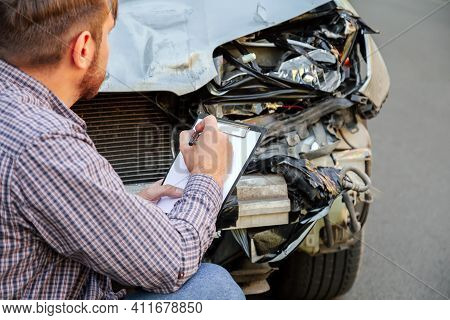 Man Insurance Agent With Auto Insurance Blank Near Destroyed Car In Car Crash Traffic Accident On Ro