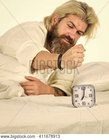 Counting Time. Early Morning Routine. Bearded Man In Bed With Alarm Clock Ringing. Time Management.